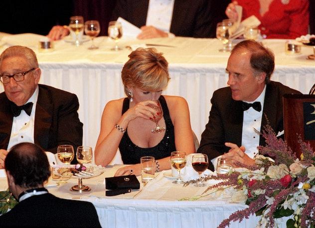 Princess Diana enjoying a drink with the guys.