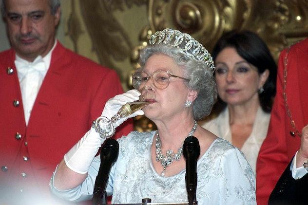 Queen Elizabeth drinks champagne.