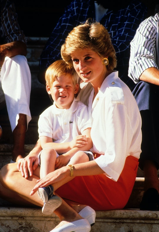 PALMA, MAJORCA - AUGUST 13:  Prince Harry sits on the lap of his mother, Diana, Princess of Wales, w...