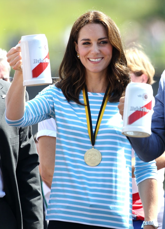 Kate Middleton drinks a beer after a rowing match.