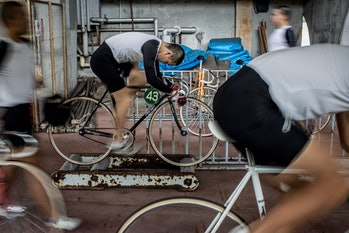 IZU, JAPAN - JULY 08:  Keirin students train on rollers at the Nihon Keirin Gakkou (Japan Keirin School) on July 8, 2015 in Izu, Japan. Keirin is a form of cycle racing developed in Japan around 1948 for gambling purposes and has since become extremely popular. It is one of only four sports that patrons are allowed to bet on. In 1957 the Japanese Keirin Association was founded establishing a uniform system for the sport. Today riders must complete study at the Japan Keirin School. For riders accepted to the school, they take on an extremely strict, 15hr, six day a week training schedule, before being eligible to graduate as approved professional Keirin riders able to compete in Japan's professional Keirin league. There are over 3000 registered riders in Japan and salaries for top riders can bring in as much as 2million USD, average riders can bring in salaries of 100,000USD. Despite its popularity, Keirin racing has seen a steady decline since the 1990's with attendance and revenue declining consistently. With Japan's ageing population and Keirin seen mainly as a gambling activity, it's fan base is made up primarily of punters over the age of 50. Attracting young fans is a crucial step to reinvigorating the sport. However the lack of interest from young Japanese in sports betting and the  popularity of baseball and football, attracting younger spectators is an up hill battle. The JKA has taken steps to attract younger fans, In 2012 women's racing was reintroduced under the name, Girl's Keirin and  promoted with a national TV advertising campaign showing riders in high heels and dresses as an attempt to attract younger viewers. With the current debate in Japan over the introduction of casinos and the popularity of Pachinko slot gambling with the younger generation, Keirin racing could see yet another decline.  (Photo by Chris McGrath/Getty Images)