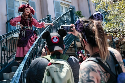 naheim, CA, Friday, April 30, 2021 - Red the pirate chats with guests from an appropriate distance outside the Pirates of the Caribbean attraction. A limited number of people come to Disneyland the first day after closing more than a year ago.  (Robert Gauthier/Los Angeles Times via Getty Images)