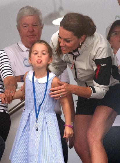 COWES, ENGLAND - AUGUST 08:  Princess Charlotte of Cambridge sticks out her tongue much to the amuse...