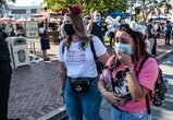 Anaheim, CA, Friday, April 30, 2021 - Megan Reeves, right and Melissa Orlandi join a limited number of people come to Disneyland the first day after closing more than a year ago. Rivas said she was weeping because were back.  Its a sign of hope that one day we will be normal.  And just the sounds, the smells are a sign of hope, she said as she walked down Main St  (Robert Gauthier/Los Angeles Times via Getty Images)
