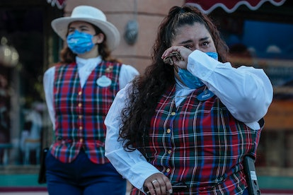Anaheim, CA, Friday, April 30, 2021 - A Disneyland host weeps as they gather minutes before reopenin...
