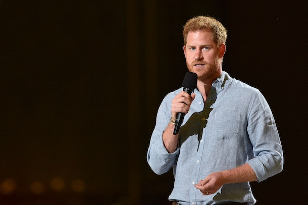 """Co-Chair Britain's Prince Harry, Duke of Sussex, gestures as he speaks onstage during the taping of the """"Vax Live"""" fundraising concert at SoFi Stadium in Inglewood, California, on May 2, 2021. - The fundraising concert """"Vax Live: The Concert To Reunite The World"""", put on by international advocacy organization Global Citizen, is pushing businesses to """"donate dollars for doses,"""" and for G7 governments to share excess vaccines. The concert will be pre-taped on May 2 in Los Angeles, and will stream on YouTube along with American television networks ABC and CBS on May 8. (Photo by VALERIE MACON / AFP) (Photo by VALERIE MACON/AFP via Getty Images)"""