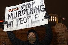 COLUMBUS, OH - APRIL 20: Black Lives Matter activist holds a sign against police brutality in front ...