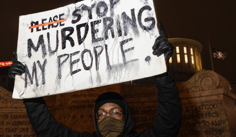 COLUMBUS, OH - APRIL 20: Black Lives Matter activist holds a sign against police brutality in front of the Ohio Statehouse in reaction to the shooting of Makiyah Bryant on April 20, 2021 in Columbus, Ohio. Columbus Police Shot and killed Makiyah Bryant, 16 years old, on April 20, 2021 sparking outrage from the community. (Photo by Stephen Zenner/Getty Images)