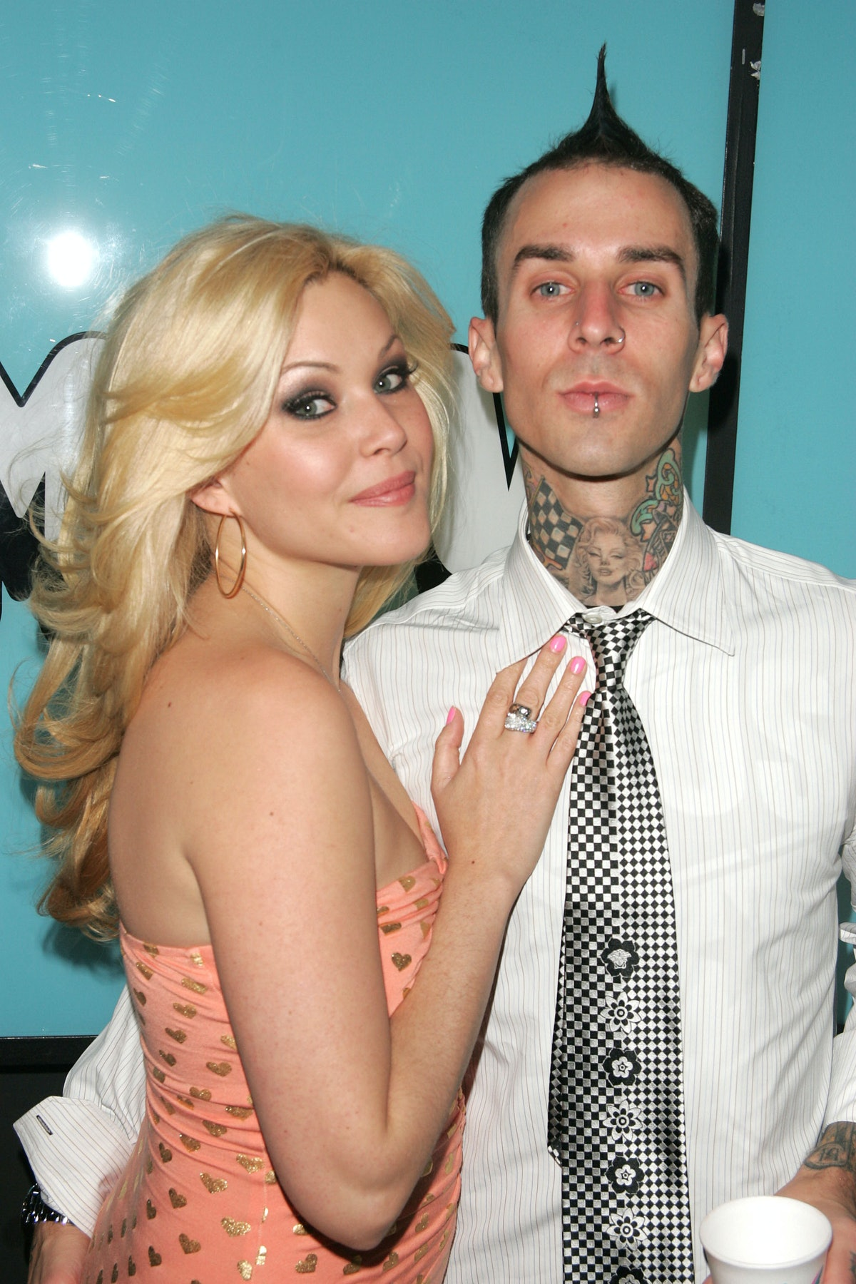 """NEW YORK - APRIL 6:  (U.S. TABLOIDS OUT)  From """"Meet The Barkers"""" Shanna Moakler and Travis Barker make an appearance on MTV's Total Request Live on April 6, 2005 in New York City.  (Photo by Peter Kramer/Getty Images)"""