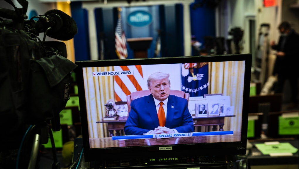 WASHINGTON, DC - JANUARY 13: President Donald J. Trump is seen on a television screen in the briefing room showing a pre recorded video posted to social media after he was impeached in the House for the second time, at the White House on Wednesday, Jan 13, 2021 in Washington, DC. (Photo by Jabin Botsford/The Washington Post via Getty Images)