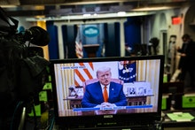 WASHINGTON, DC - JANUARY 13: President Donald J. Trump is seen on a television screen in the briefin...