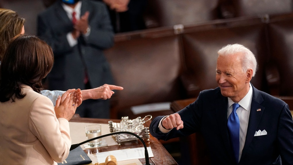 US President Joe Biden turns to Vice President Kamala Harris (C) and Speaker of the House of Representatives Nancy Pelosi (L) after addressing a joint session of Congress at the US Capitol in Washington, DC, on April 28, 2021. (Photo by Andrew Harnik / POOL / AFP) (Photo by ANDREW HARNIK/POOL/AFP via Getty Images)