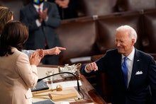 US President Joe Biden turns to Vice President Kamala Harris (C) and Speaker of the House of Represe...