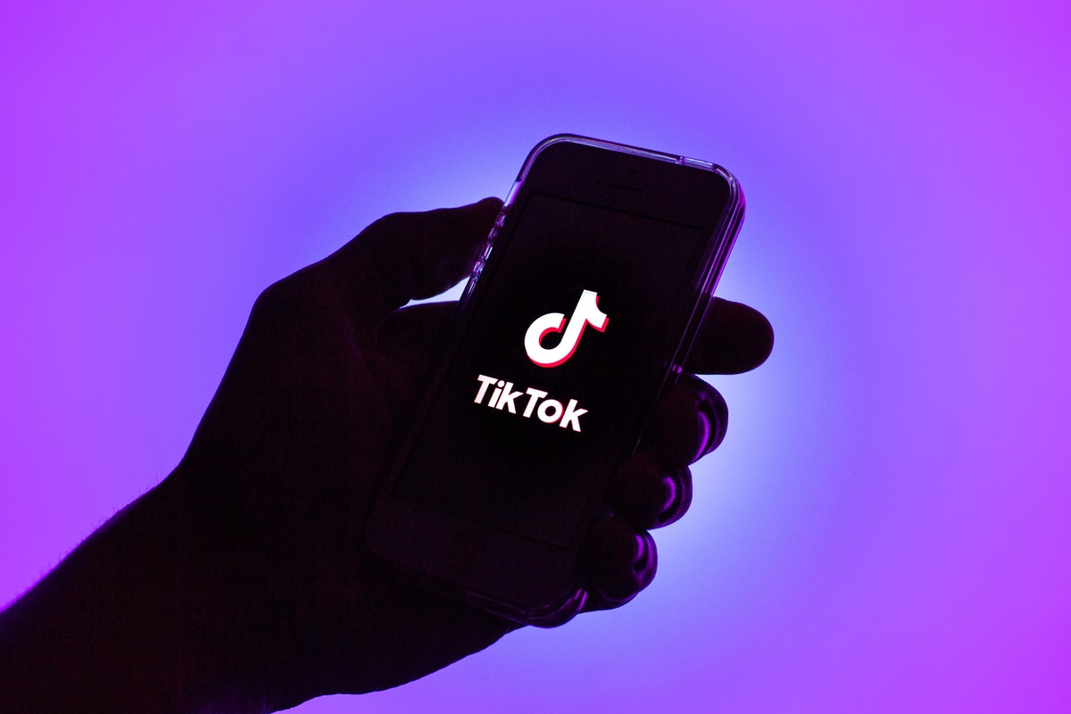 SPAIN - 2021/02/16: In this photo illustration, a Tik Tok logo seen displayed on a smartphone. (Photo Illustration by Thiago Prudêncio/SOPA Images/LightRocket via Getty Images)