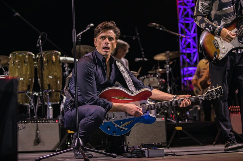 DEL MAR, CALIFORNIA - OCTOBER 24: Musician John Stamos of The Beach Boys performs on stage at Del Mar Fairgrounds on October 24, 2020 in Del Mar, California. Due to ongoing coronavirus social distance restrictions, drive-in concerts have become a popular way for fans to experience live music (Photo by Daniel Knighton/Getty Images)