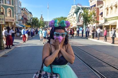 Anaheim, CA - April 30: A visitor to Disneyland get emotional as she walks up Main Street U.S.A. dur...