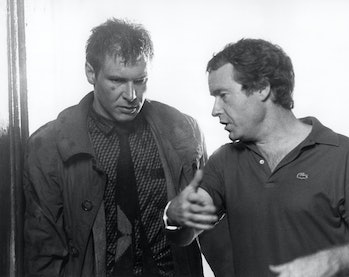 """Harrison Ford and Ridley Scott on the set of """"Blade Runner"""", directed by Ridley Scott. (Photo by Sunset Boulevard/Corbis via Getty Images)"""