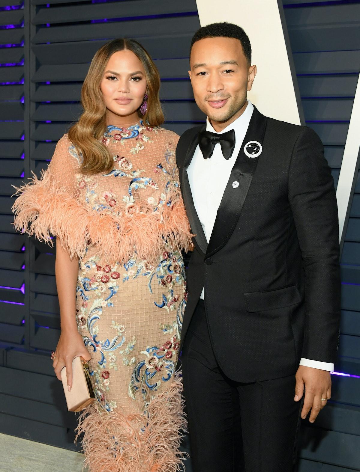 BEVERLY HILLS, CA - FEBRUARY 24:  Chrissy Teigen (L) and John Legend attend the 2019 Vanity Fair Osc...
