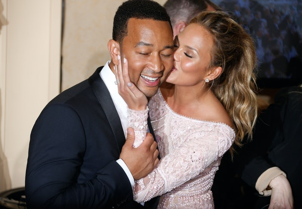 BEVERLY HILLS, CA - JANUARY 11:  Singer John Legend (L) and model Chrissy Teigen pose in the press room during the 72nd Annual Golden Globe Awards at The Beverly Hilton Hotel on January 11, 2015 in Beverly Hills, California.  (Photo by Jeff Vespa/WireImage)