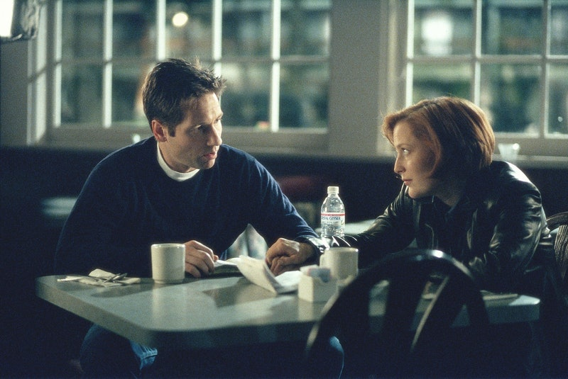 THE X-FILES - SEASON 7: Mulder (David Duchovny, L) and Scully (Gillian Anderson, R) search for clues...