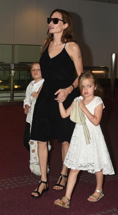 TOKYO, JAPAN - JUNE 21:  Knox Jolie-Pitt, Angelina Jolie and Vivienne Jolie-Pitt are seen upon arriv...