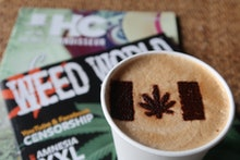 """11 October 2018, Canada, Toronto: In the cafe """"Cannabis & Coffee"""" there is a cannabis leaf as a mari..."""