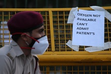 A notice pasted outside a makeshift isolation facility reads 'OXYGEN NOT AVAILABLE, CAN'T ADMIT PATI...