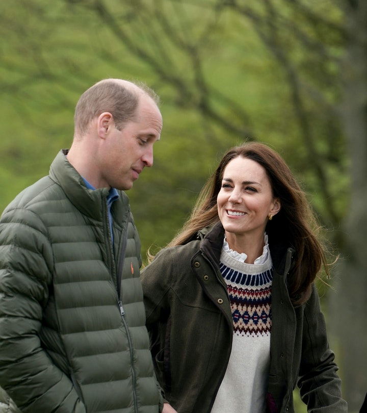 Prince William, Duke of Cambridge and Catherine, Duchess of Cambridge walk together during their vis...
