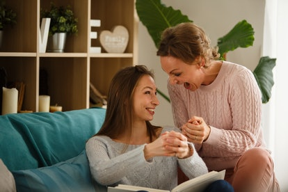 Copy space shot of cheerful mother and daughter having fun and laughing while recreating old memorie...