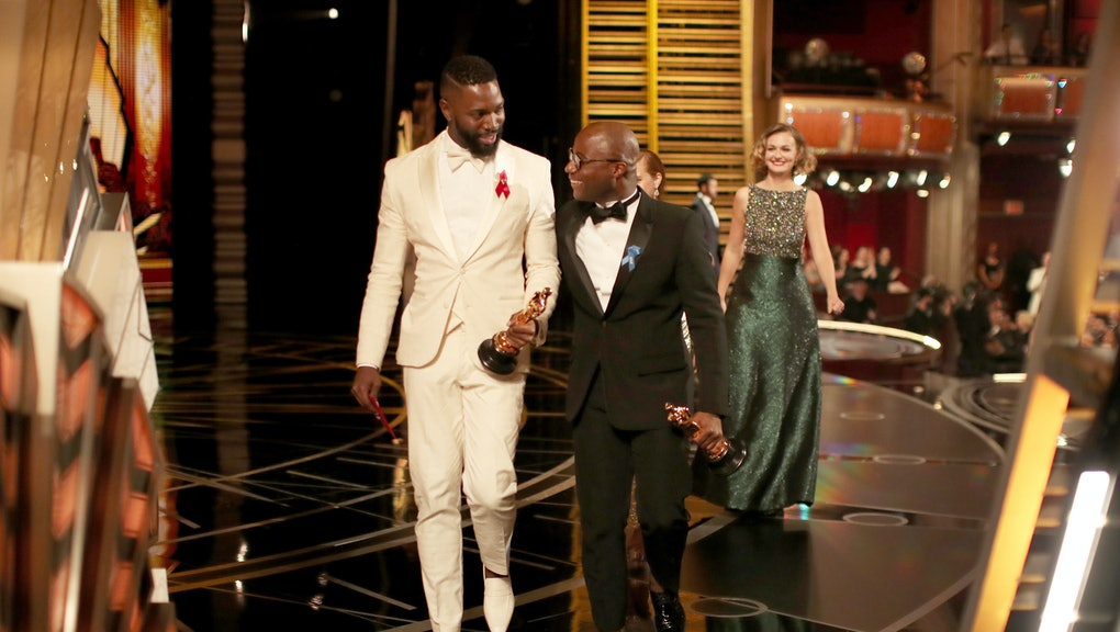 HOLLYWOOD, CA - FEBRUARY 26:  Screenwriter Tarell Alvin McCraney (L) and writer/director Barry Jenkins accept the Best Adapted Screenplay award for 'Moonlight' onstage during the 89th Annual Academy Awards at Hollywood & Highland Center on February 26, 2017 in Hollywood, California.  (Photo by Christopher Polk/Getty Images)