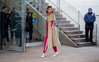 NEW YORK, NY - FEBRUARY 14: Zendaya wearing trench coat, red track suit, white heels seen outside Michael Kors on February 14, 2018 in New York City. (Photo by Christian Vierig/Getty Images)