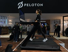 LAS VEGAS, NV - JANUARY 11:  Maggie Lu uses a Peloton Tread treadmill during CES 2018 at the Las Veg...