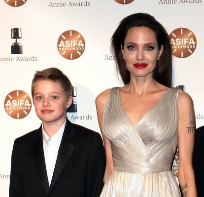 LOS ANGELES, CA - FEBRUARY 03:  Shiloh Nouvel Jolie-Pitt (L) and mother actress Angelina Jolie atten...
