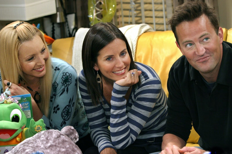 """BURBANK, CA - SEPTEMBER 12:  (EXCLUSIVE, NO U.S. TABLOID SALES)  (L-R) Lisa Kudrow, Courteney Cox Arquette, and Matthew Perry relax on the set of the hit NBC series """"Friends""""during a break on one of their last shows on the Warner Bros lot Sept. 12, 2003 in Burbank, CA. """"Friends,"""" which is in its ninth and final season, debuted in 1994, has won 44 Emmys, and is one of the biggest successes in television history.  (Photo by David Hume Kennerly/Getty Images) This image is not included in any subscription deal. Use of this image will incur a charge."""
