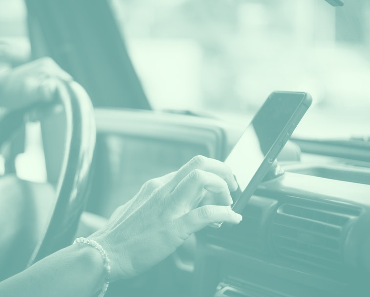 Portrait of woman hands setting up the gps car navigator on the phone - people and internet connection inside vehicle - travel and road trip concept for modern communication service - messaging