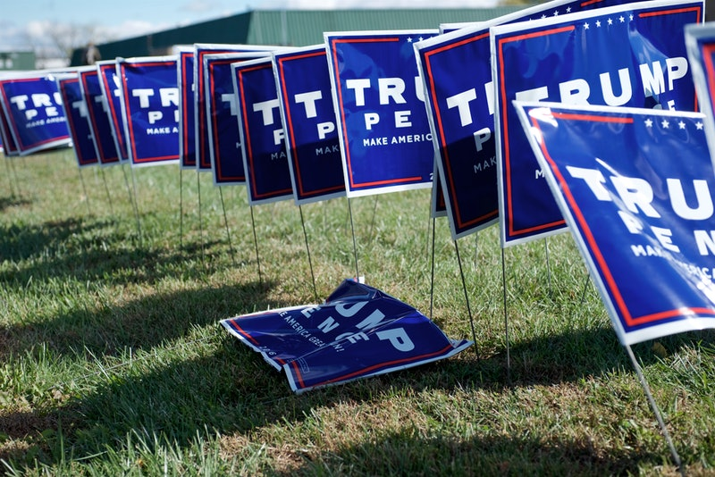 Trump/Pence Make America Great Again 2016 presidential campaign lawn signs sit on the side of the road. Millennials with Trump-supporting parents are navigating how to restore their relationships after Biden's election.