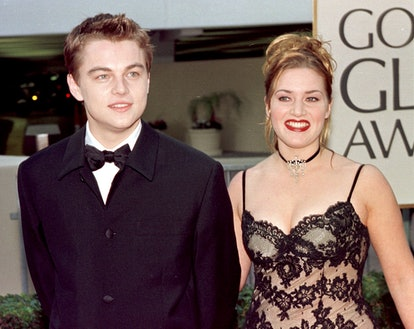 """BEVERLY HILLS, CA - JANUARY 18:  Actor Leonardo DiCaprio (L) arrives with co-star Kate Winslet for the 55th Annual Golden Globe Awards at the Beverly Hilton 18 January  in Beverly Hills, CA.  DiCaprio is nominated for Best Actor in the drama category for his role in """"Titanic"""". """"Titanic"""" is also nominated for Best Picture, Best Director and Best Actress in the same category.  (Photo credit should read HAL GARB/AFP via Getty Images)"""