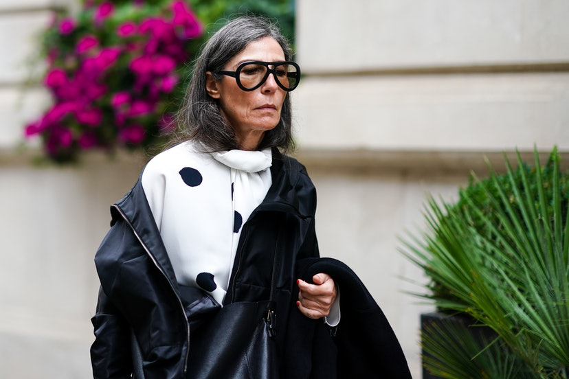 LONDON, ENGLAND - SEPTEMBER 16: A guest wears sunglasses, a white top with printed large polka dots, during London Fashion Week September 2019 on September 16, 2019 in London, England. (Photo by Edward Berthelot/Getty Images)