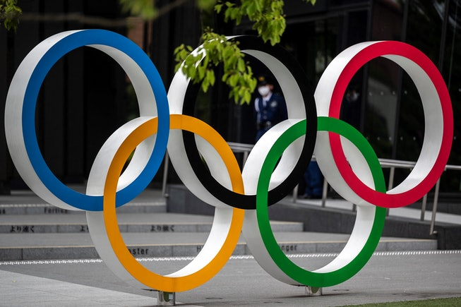 Security guards are seen through the Olympic Rings near the National Stadium for the Tokyo 2020 Olym...