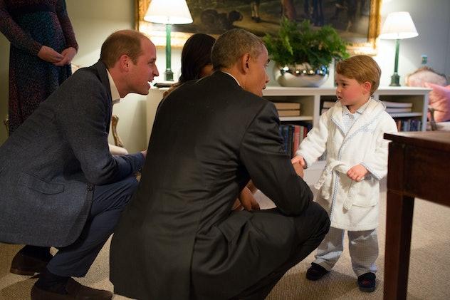 Prince George greeted Barack Obama in his robe.