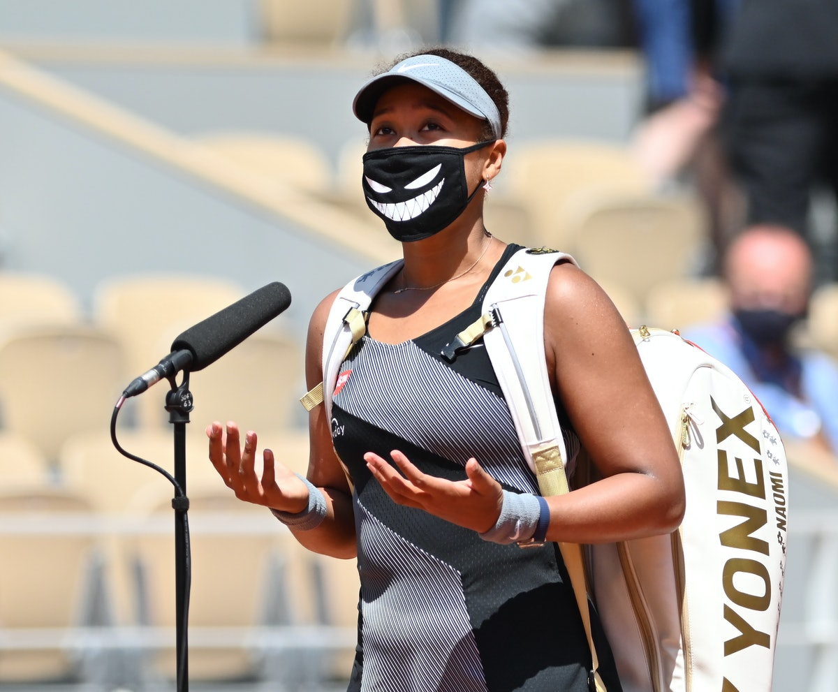 PARIS, FRANCE - MAY 30: Naomi Osaka of Japan gestures after winning match against Patricia Maria Tig (not seen) of Romania in the first round of the women singles during the French Open Tennis Tournament at Roland Garros in Paris, France on May 30, 2021. (Photo by Mustafa Yalcin/Anadolu Agency via Getty Images)