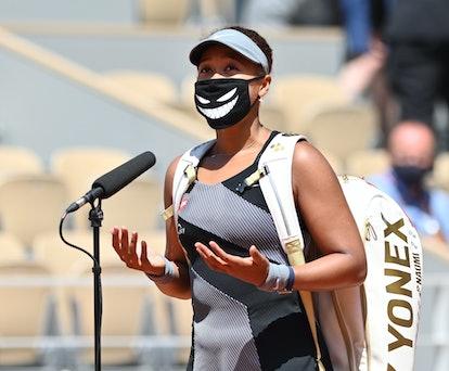 PARIS, FRANCE - MAY 30: Naomi Osaka of Japan gestures after winning match against Patricia Maria Tig...