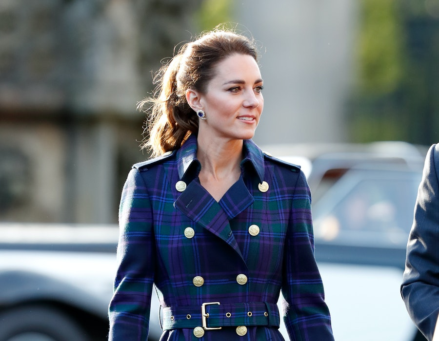 Kate Middleton wore an elegant coat look while hosting a drive-in cinema screening of Disney's 'Cruella' for Scottish NHS workers at The Palace of Holyroodhouse in Edinburgh, Scotland on May 26. The look stands in contrast to the more casual outfit she wore for her COVID-19 vaccination.