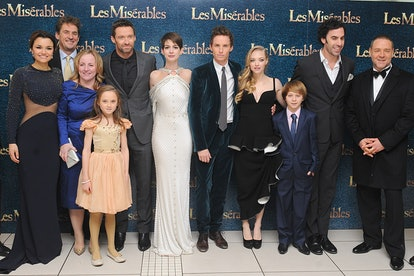 Samantha Barks, Cameron Mackintosh and guest,  Isabelle Allen, Hugh Jackman, Anne Hathaway, Eddie Redmayne, Amanda Seyfried, Daniel Huttlestone, Sacha Baron Cohen and Russell Crowe  arrives at the premiere of Les Miserables at the Empire Leicester Square, London, UK   (Photo by Ian West/PA Images via Getty Images)