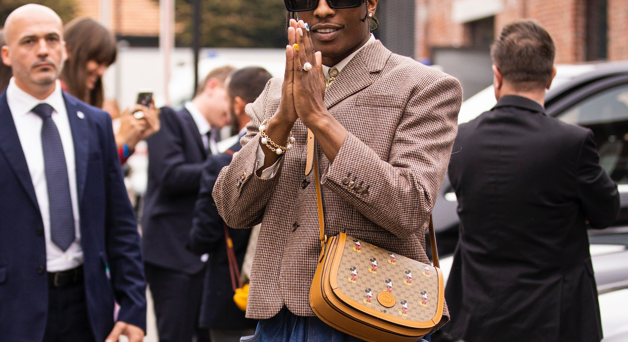 MILAN, ITALY - SEPTEMBER 22:  ASAP Rocky, wearing brown blazer, blue jeans, Gucci bag and Gucci shoe...