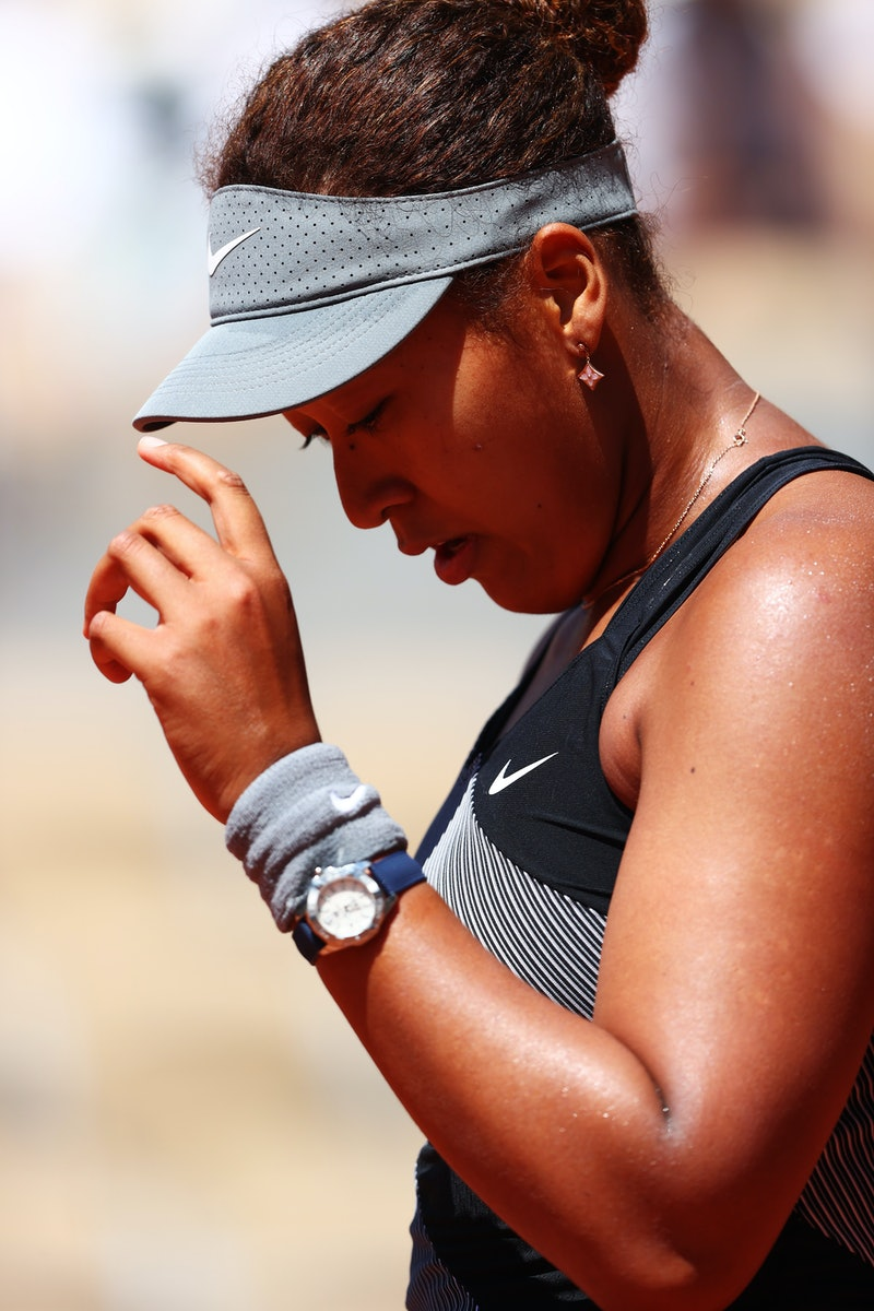 PARIS, FRANCE - MAY 30: Naomi Osaka of Japan reacts in her First Round match against Patricia Maria Tig of Romania during Day One of the 2021 French Open at Roland Garros on May 30, 2021 in Paris, France. (Photo by Julian Finney/Getty Images)