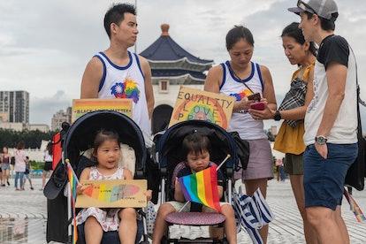 Family at an LGBT Pride Parade.