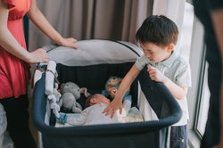 Toddlers may seem uninterested in their baby sibling, but experts have ideas on how to help.