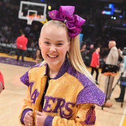 LOS ANGELES, CALIFORNIA - FEBRUARY 10: JoJo Siwa attends a basketball game between the Los Angeles Lakers and Phoenix Suns at Staples Center on February 10, 2020 in Los Angeles, California. (Photo by Allen Berezovsky/Getty Images)