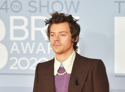Harry Styles, who fans are convinced may be launching a perfume line, posing on the red carpet at th...